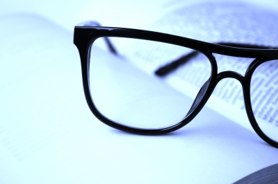 Eyeglasses resting on an open book