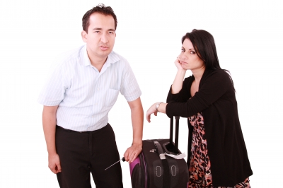 couple leaning on luggage