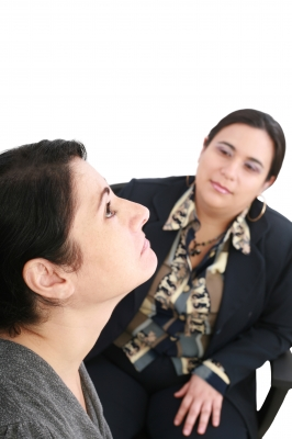 therapist listening to a patient