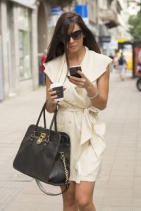 woman texting and walking
