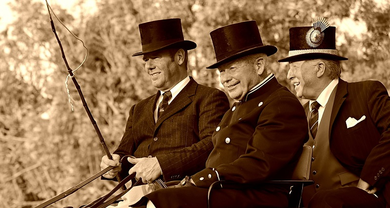 3 coachmen wearing top hats