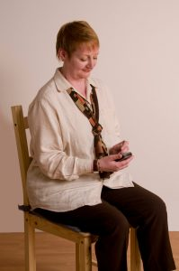woman texting with good posture