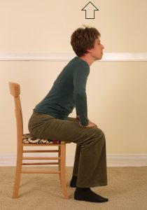 woman struggling to stand up