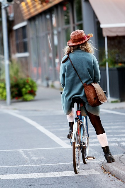 girl on bike with bag across her body