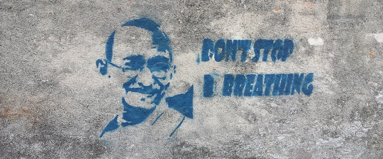"graffiti that says ""don't stop breathing"""