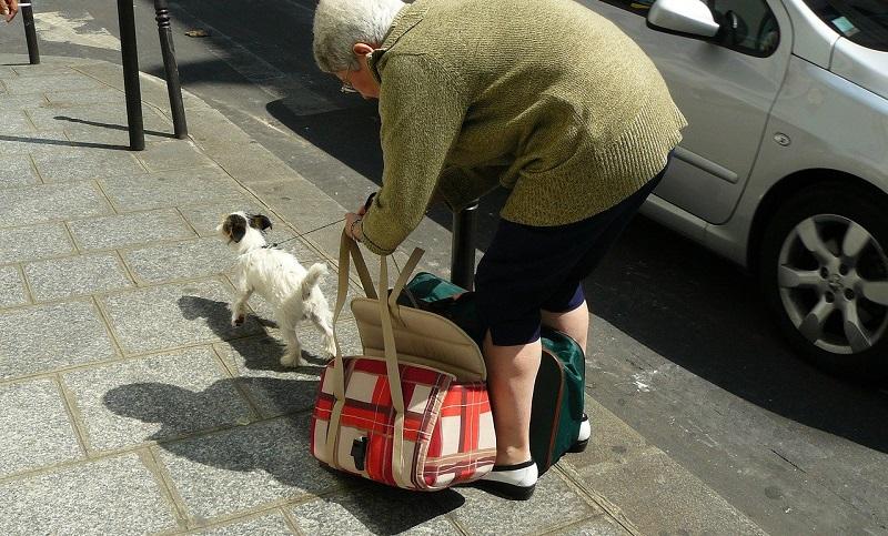 elderly woman bending over